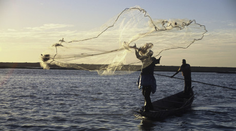 Artisenal fishermen on the Niger River at sunset near Mopti, Mali.